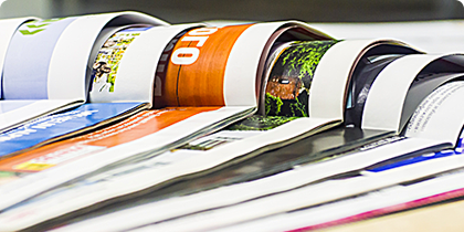 Glossy magazines, books, promotional literature